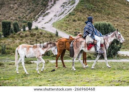 QUITO, ECUADOR - JAN 4, 2015: Unidentified Ecuadorian man in poncho riding a horse. 71,9% of Ecuadorian people belong to the Mestizo ethnic group
