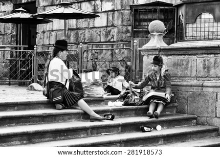 QUITO, ECUADOR - JAN 2, 2015: Unidentified Ecuadorian people in the street in Quito. 71,9% of Ecuadorian people belong to the Mestizo ethnic group