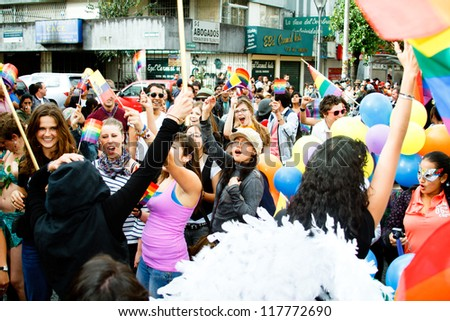 QUITO, ECUADOR JULY 03: Unidentified people participate Gay Pride parade, one of the famous gay parade in the americas. 2011, JULY 03, QUITO, ECUADOR - stock photo