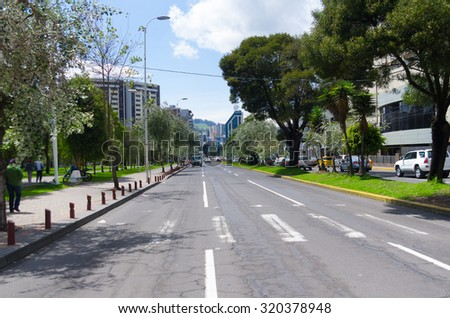 QUITO, ECUADOR- MARCH 20, 2015: Great image from modern part of Quito mixing new architecture with charming streets and green sourroundings. - stock photo
