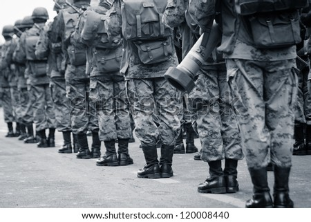 QUITO, ECUADOR- MAY 24 : National  military parade, unidentified camouflage  soldiers with ammo and military gear in row formation. May 24, 2012, Quito, Ecuador - stock photo