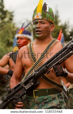 QUITO, ECUADOR- MAY 24:  National  military parade, unidentified indigenous row of soldiers with army and military gear on May 24, 2012, Quito, Ecuador - stock photo
