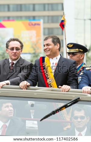 QUITO, ECUADOR- MAY 24 2012 National  millitary parade, Ecuador's President Rafael Correa  and minister on a military vehicle. May 24, 2012, Quito, Ecuador