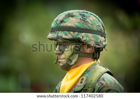 QUITO, ECUADOR- MAY 24 2012 National  millitary parade, unidentified camouflage  soldier with armo and military gear. May 24, 2012, Quito, Ecuador - stock photo