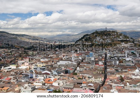 Quito - the capital of Ecuador. Quito is a beautifllly set city, packed with historical monuments and architectural treasures. The picture present view on the colonial old town in Quito (UNESCO) - stock photo