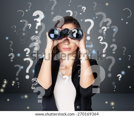 Quiz. Handsome business man with binoculars and question marks above his head - stock photo