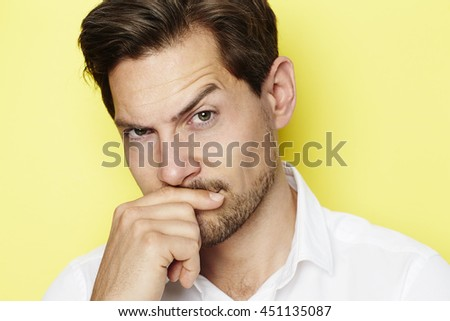 stock-photo-quizzical-man-raising-eyebro