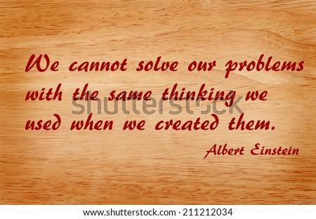 Quote by Albert Einstein on wooden background - stock photo