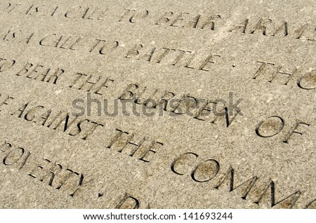 Quote engraved in stone in Arlington Cemetery Memorial - stock photo