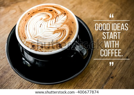 Quote with coffee on wood background - stock photo