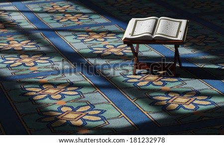 Quran - holy book of Muslims, in the Malaysian mosque - stock photo