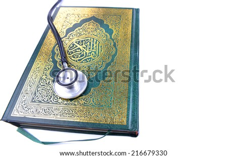 Quran with stethoscope. Concepts of medication and healthcare in islam.  - stock photo