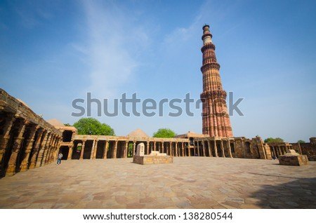 qutub minar the tallest brick tower in the world in india - stock photo