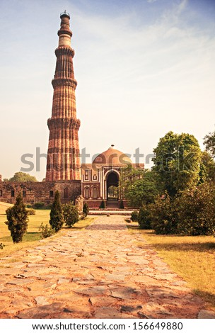 Qutub Minar Tower brick minaret in  Delhi India - stock photo
