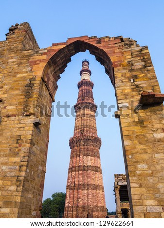 Qutub Minar Tower or Qutb Minar, the tallest brick minaret in the world , Delhi India. - stock photo