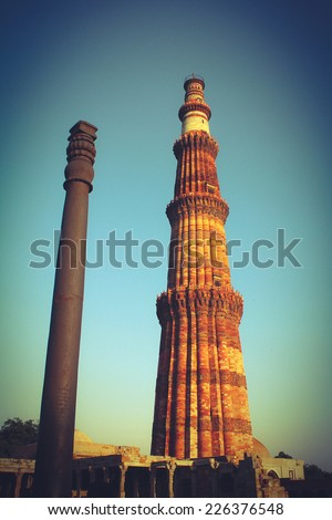 qutub minar with iron pillar - stock photo
