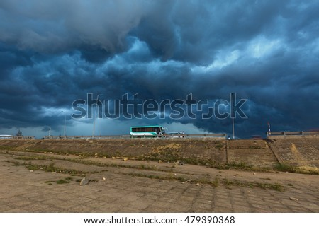 Quy Nhon City, Binh Dinh Province, Vietnam - August 27, 2016: Images buses parked to await tourists at the same time a storm with dark clouds are pulling ahead. danger and impressive