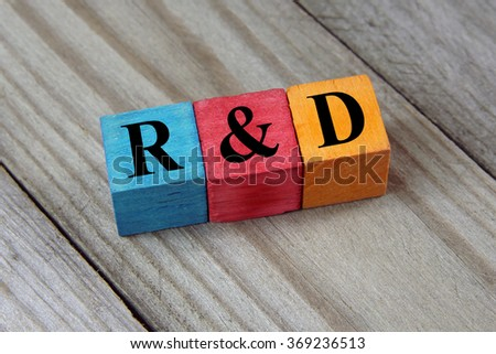 R&D (Research and development) text on colorful wooden cubes