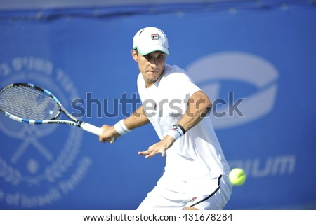 RAANANA, ISRAEL - April 02, 2016: Professional tennis player Evgeny Donskoy in action at the semi-final match during the ATP Challenger Tour 2016 at Raanana