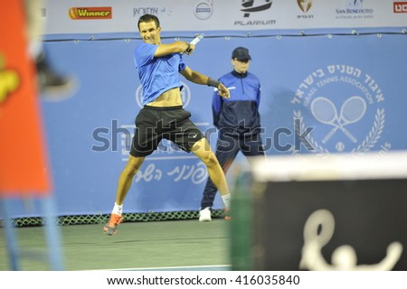 RAANANA, ISRAEL - April 03, 2016: Professional tennis player Evgeny Donskoy in action during the ATP Challenger Tour 2016 at Raanana  - stock photo