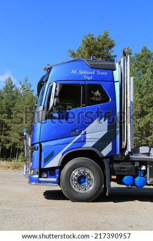 RAASEPORI, FINLAND - SEPTEMBER 14, 2014: FH16 Volvo Ocean Race Limited Edition trucks have The Sphlash Element on the cab sides.