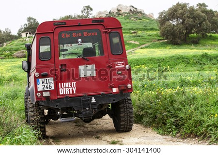 RABAT, MALTA - JANUARY 19, 2014: A Land Rover Defender 110 in the countryside of Rabat in Malta - stock photo