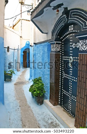RABAT, MOROCCO - MAY 14 2006: Ornate door and narrow pedestrian streets in the residential part of the ancient Kasbah of the Udayas in Rabat, the capital city of Morocco.
