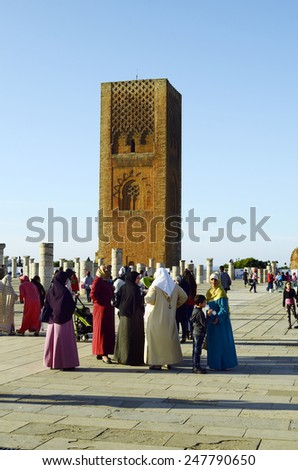 RABAT, MOROCCO - NOVEMBER 18: Unidentified tourists and woman in traditional Kaftan sightseeing on the place of Hassan tower - a landmark of the city, on November 18, 2014 in Rabat, Morocco - stock photo