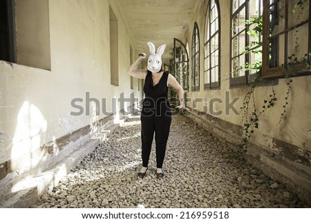 Rabbit attack woman in abandoned house, halloween - stock photo