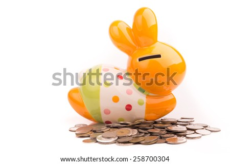 Rabbit bank and coins on White Isolated background - stock photo