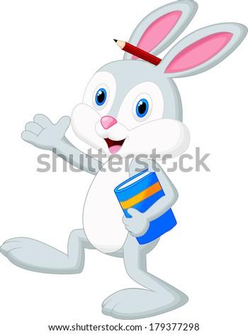 Rabbit cartoon holding book - stock photo