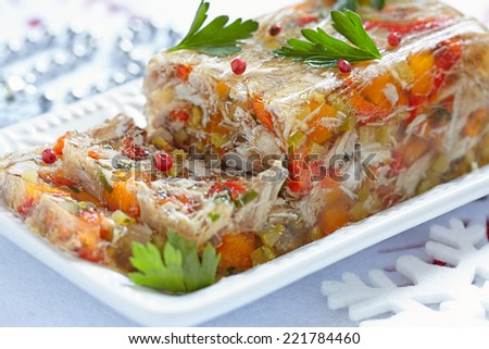 Rabbit galantine aspic with vegetables for Christmas - stock photo