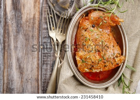 Rabbit meat with herbs - stock photo
