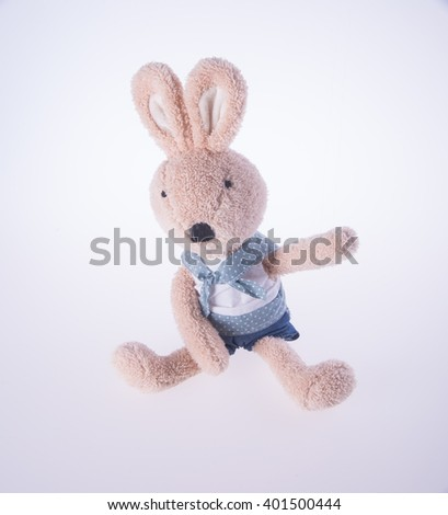 rabbit or stuffed animal toy on a background - stock photo