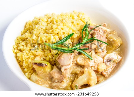 Rabbit stew with vegetables closeup on white plate - stock photo