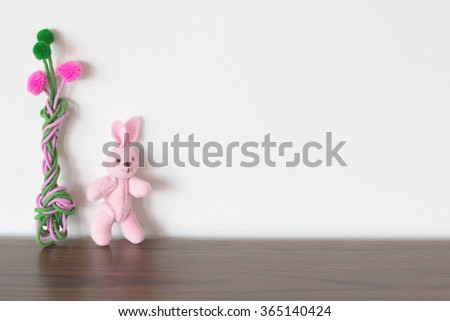 rabbit toy and colorful tree - stock photo