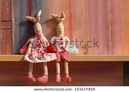 Rabbits in love cute wedding card invitation Valentines day with copy space on painted background - stock photo
