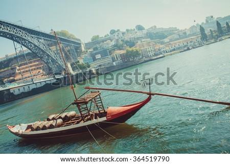Rabelo boat, wine transport on Douro river, Porto. - stock photo