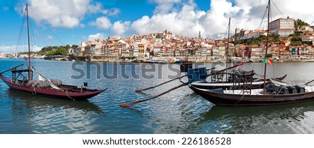 Rabelo boats in old Porto, Portugal  - stock photo
