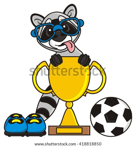 raccoon wearing glasses and with his tongue hanging out sitting in a gold soccer ball  cup near the football boots and ball - stock photo