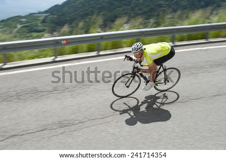 race biker by road cycling downhill - stock photo