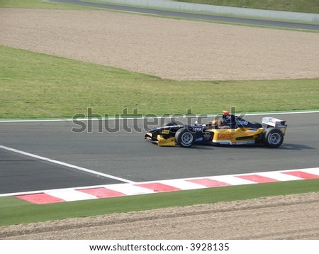 Race car in the complexe du lycee - corner at Circuit Magny-Cours Nevers racetrack (France)