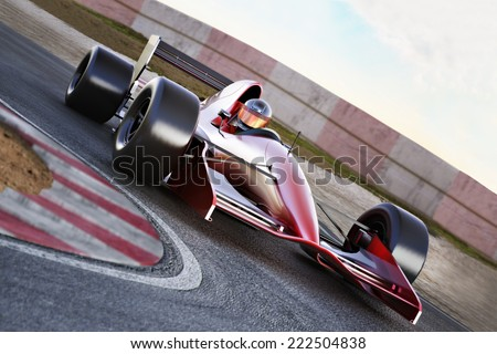 Race car racing into a turn on a track with motion blur. - stock photo
