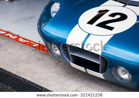 Race car racing on a track - stock photo