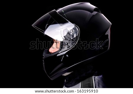 race driver isolated in dark background