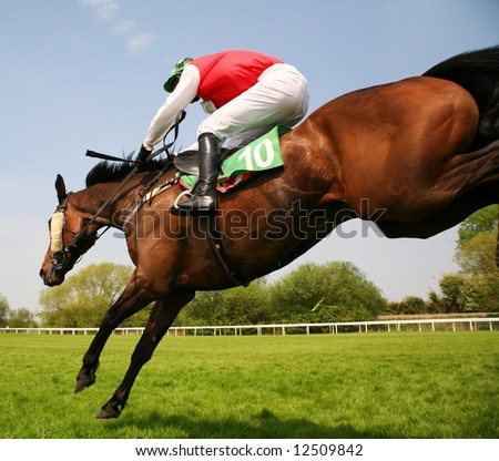 race horses jumping hurdles at speed - stock photo