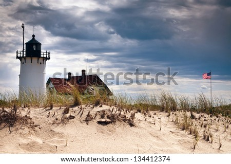 Race Point Lighthouse as storm approaches. - stock photo