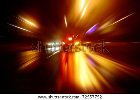 Race through the city by car at night - stock photo