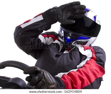 racerwearing red racing suit and blue helmet on a steering wheel - stock photo