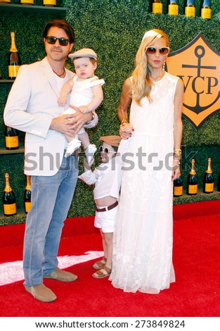 Rachel Zoe and Rodger Berman at the Fifth Annual Veuve Clicquot Polo Classic held at the Will Rogers State Historic Park in Los Angeles on October 11, 2014 in Los Angeles, California.  - stock photo